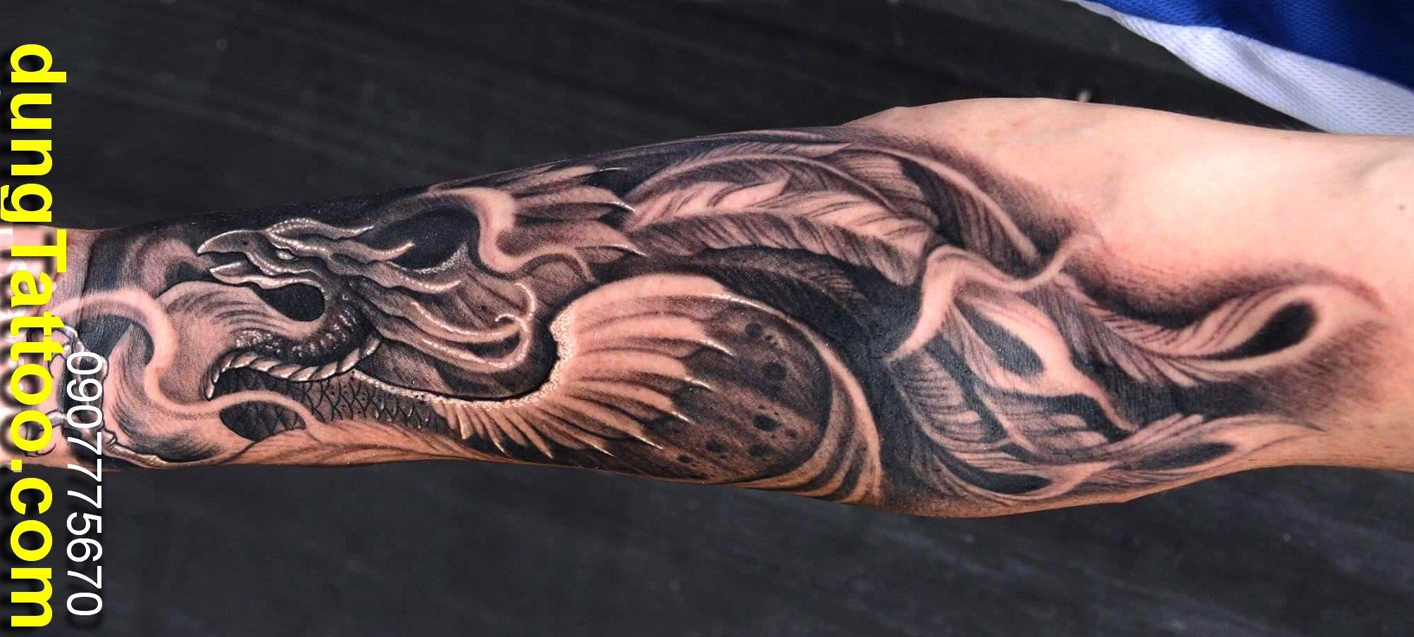hình xăm đẹp trên cánh tay phượng hoàng dành cho anh tuổi dậu thực hiện dũng tatoo 0907775670